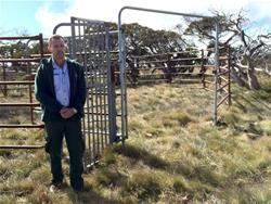ACT Parks and Conservation manager Brett McNamara next to a steel yard used to trap wild horses. ABC News: Mark Moore