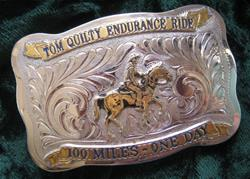 All competitors who finish with their horses passing the vet check win a prized Quilty belt buckle.